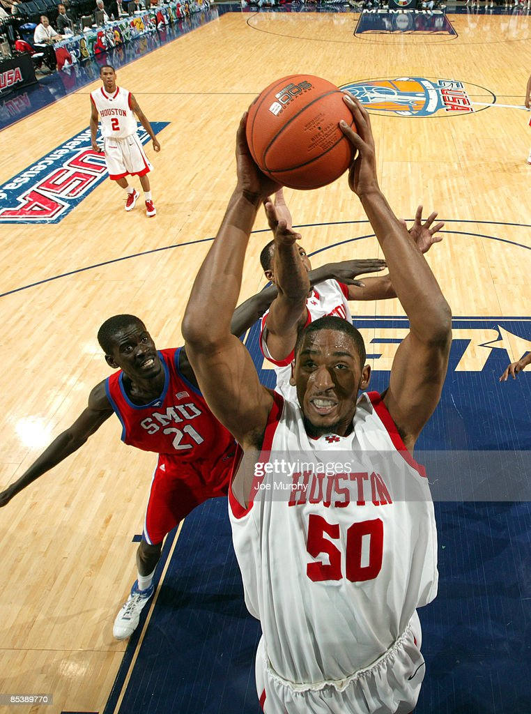 Marcus Cousin #50 of the Houston Cougars pulls down a rebound against Bamba Fall #21 of the SMU Mustangs during Round One of the Conference USA Basketball Tournament at FedExForum on March 11, 2009 in Memphis, Tennessee. Houston beat SMU