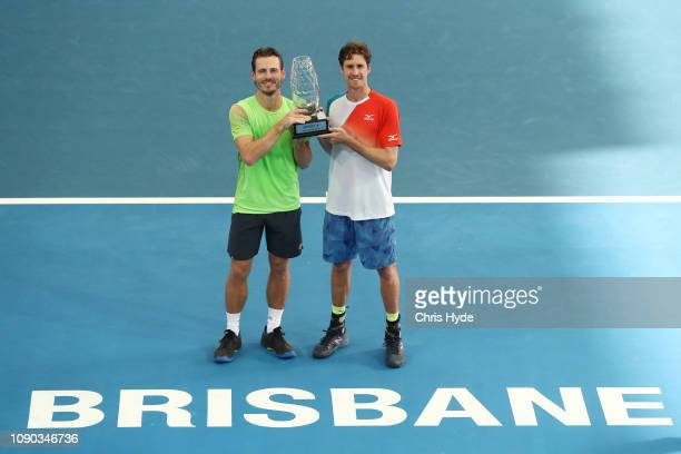 Marcus Daniell of New Zealand and Wesley Koolhof of the Netherlands hold the winners trophy after the Men's Doubles Final match against Joe Salisbury...
