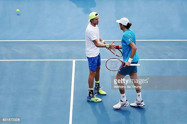 Marcus Daniell of New Zealand celebrates with Marcelo Demoliner of Brazil in their doubles match against Guillermo Duran of Argentina with Joao Sousa...