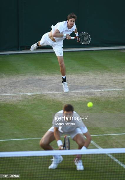 Marcus Daniell of New Zealand serves with Marcelo Demoliner of Brazil in their Gentlemen's Doubles third round match against Ken Skupski and Neal...