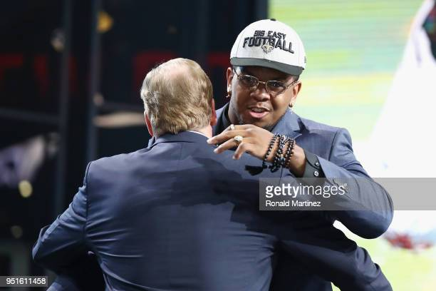 Marcus Davenport of UTSA greets NFL Commissioner Roger Goodell after he was picked overall by the New Orleans Saints during the first round of the...