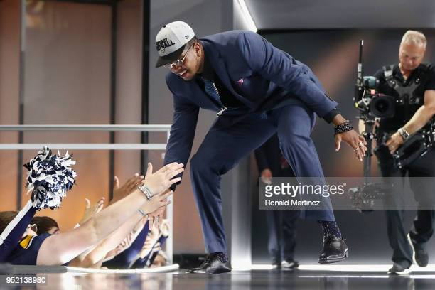 Marcus Davenport of UTSA high fives fans after being picked overall by the New Orleans Saints during the first round of the 2018 NFL Draft at ATT...