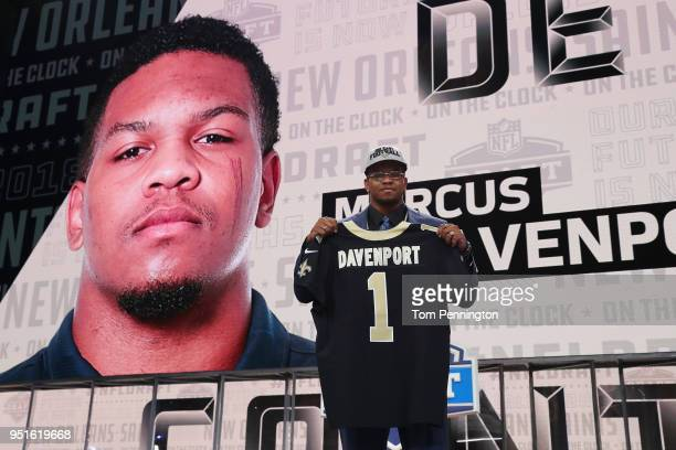 Marcus Davenport of UTSA poses after being picked overall by the New Orleans Saints during the first round of the 2018 NFL Draft at ATT Stadium on...