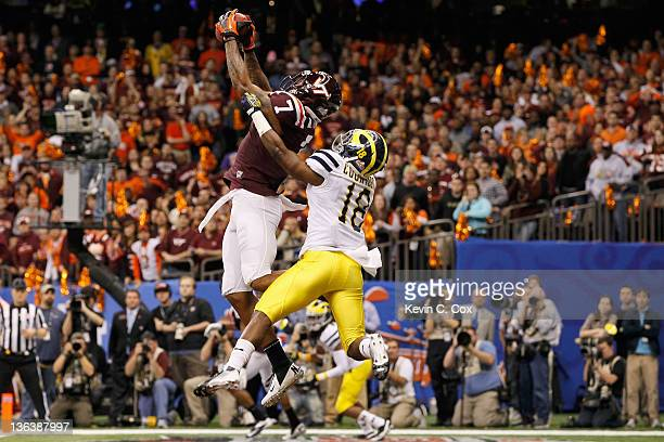 Marcus Davis of the Virginia Tech Hokies catches a successful 2-pont conversion on the fourth quarter against Blake Countess of the Michigan...
