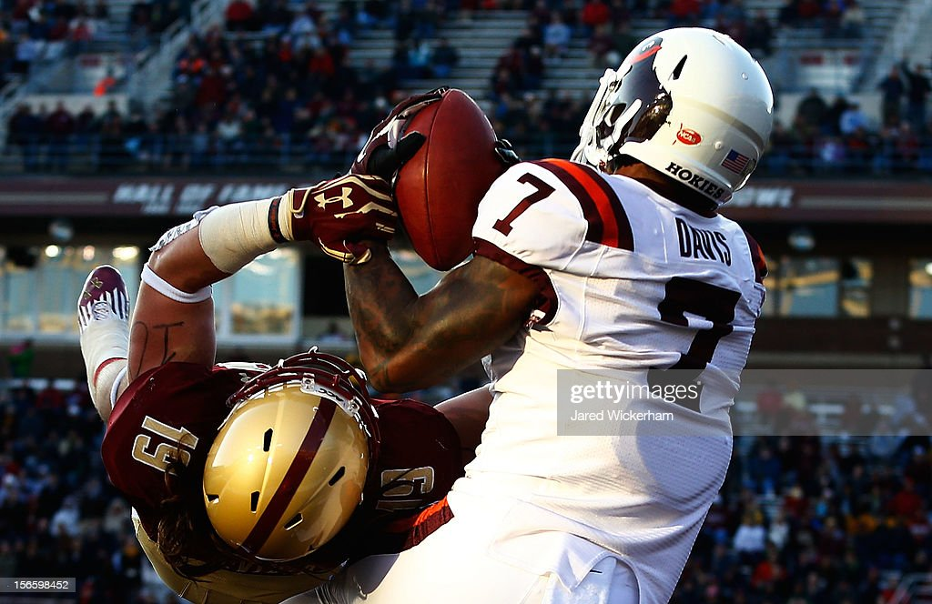 Marcus Davis #7 of the Virginia Tech Hokies catches a touchdown pass in front of Austin Lommen #19 of the Boston College Eagles in the second half during the game on November 17, 2012 at Alumni Stadium in Chestnut Hill, Massachusetts.