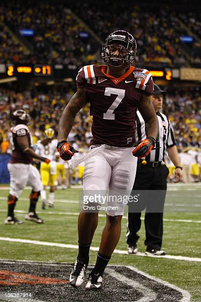 Marcus Davis of the Virginia Tech Hokies celebrates after he caught a 2point conversion in the fourth quarter against the Michigan Wolverines during...