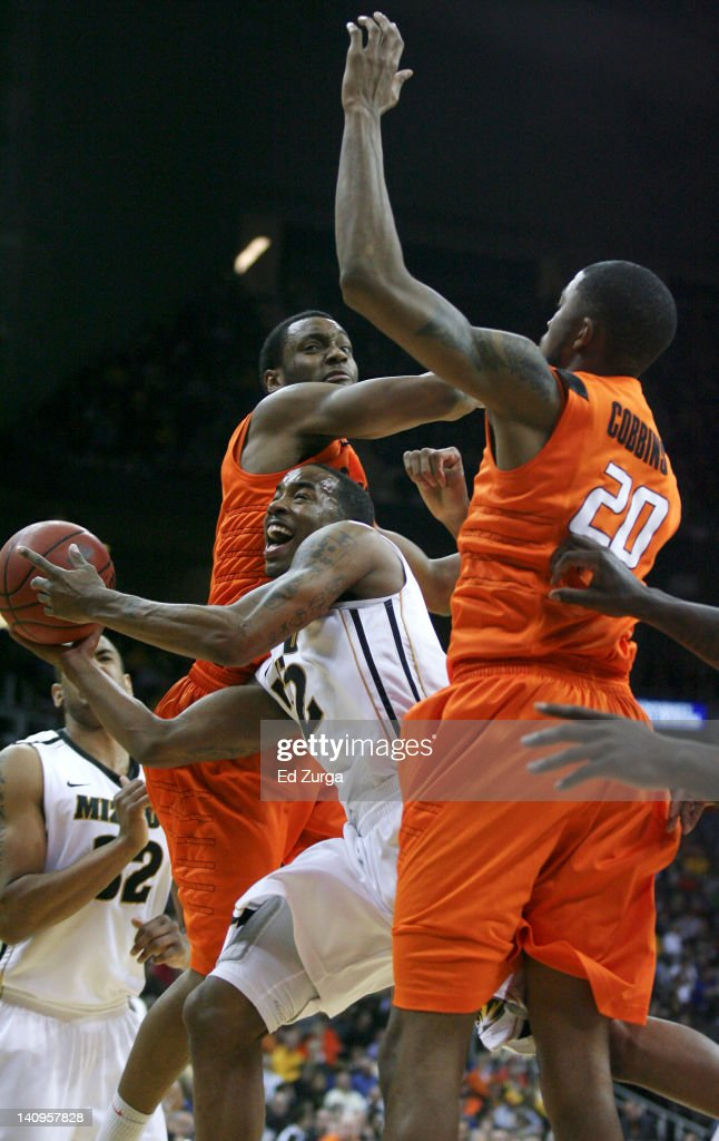 Marcus Denmon #12 of the Missouri Tigers drives to the goal between Brian Williams #4 and Michael Cobbins #20 of the Oklahoma State Cowboys during the quarterfinals of the Big 12 Basketball Tournament March 8, 2012 at Sprint Center in Kansas City, Missouri.
