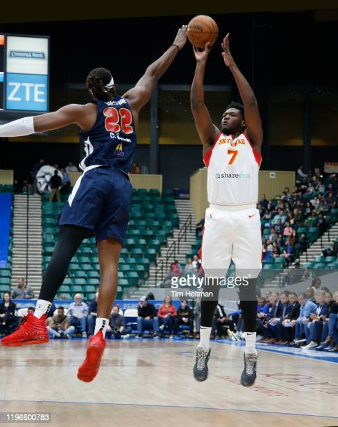 Marcus Derrickson of the College Park Skyhawks shoots over Chad Brown of the Texas Legends during the first quarter on January 26, 2020 at Comerica...