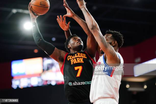 Marcus Derrickson of the College Park Skyhawks shoots over Donta Hall of the Grand Rapids Drive during the fourth quarter an NBA GLeague game on...