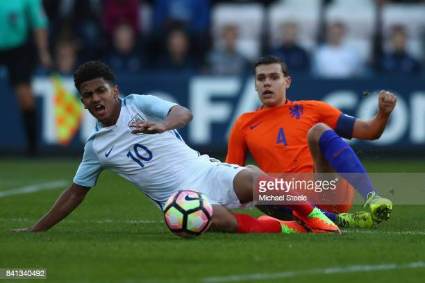 Marcus Edwards of England is fouled by Justin Hoogma of Netherlands during the international match between England U20's and Netherlands U20's at the...