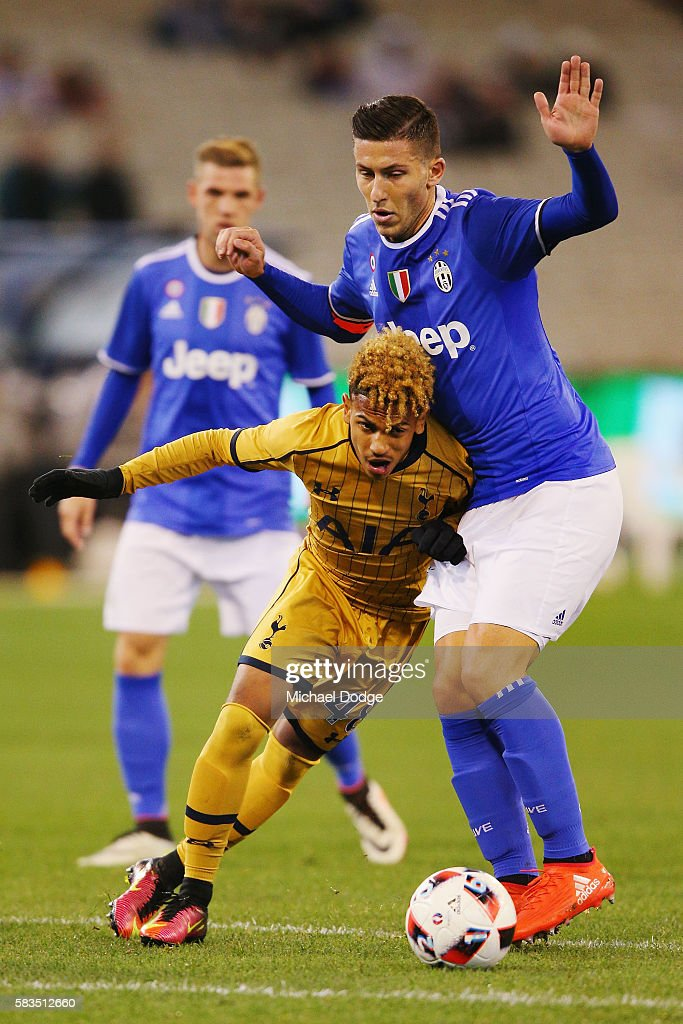 Marcus Edwards of Tottenham compete for the ball under Luca Marrone of Juventus during the 2016 International Champions Cup match between Juventus FC and Tottenham Hotspur at Melbourne Cricket Ground on July 26, 2016 in Melbourne, Australia.