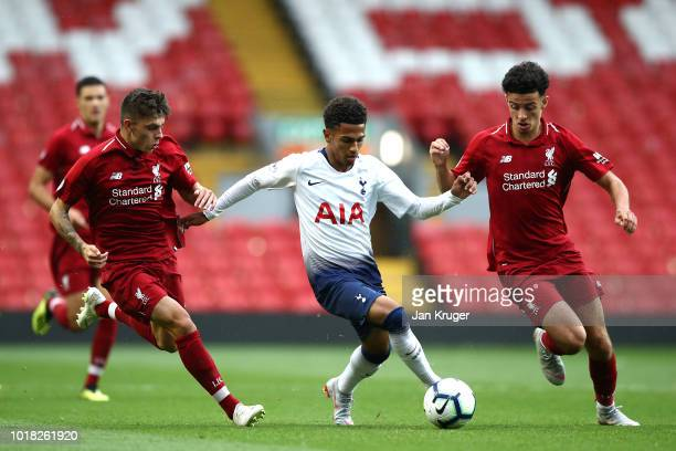 Marcus Edwards of Tottenham Hotspur battles with Adam Lewis and Curtis Jones of Liverpool during the Premier League 2 match between Liverpool at...