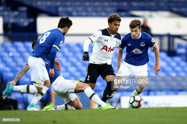 Marcus Edwards of Tottenham Hotspur is tackled by Muhamed Besic of Everton during the Premier League 2 match between Everton and Tottenham Hotspur at...