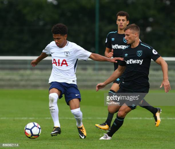 Marcus Edwards of Tottenham Hotspur Under 23s holds of Noha Sylvestre of West Ham United Under 23s during Premier League 2 Div 1 match between...