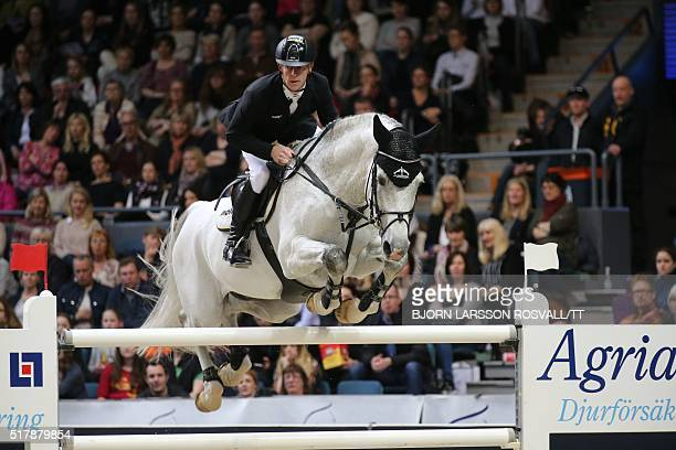 Marcus Ehning Germany rides his horse Cornado NRW during the Longines FEI World Cup Jumping Final III event of the Gothenburg Horse Show at...