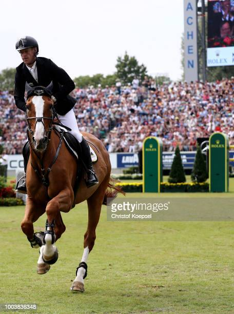 Marcus Ehning of Germany rides on Pret a Tout and celebrates winning the Rolex Grand Prix of CHIO Aachen 2018 at Aachener Soers on July 22 2018 in...