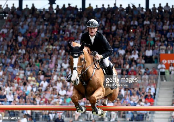 Marcus Ehning of Germany rides on Pret a Tout and wins the Rolex Grand Prix of CHIO Aachen 2018 at Aachener Soers on July 22 2018 in Aachen Germany