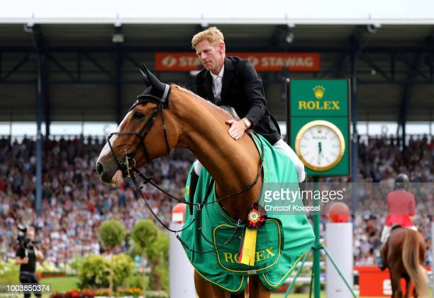 Marcus Ehning of Germany rides on Pret a Tout celebrates winning the Rolex Grand Prix of CHIO Aachen 2018 at Aachener Soers on July 22 2018 in Aachen...