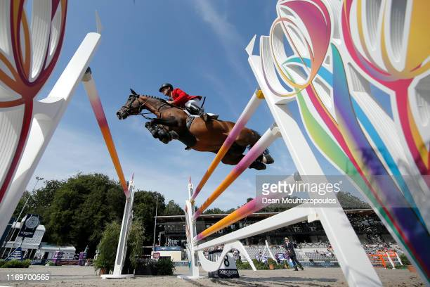 Marcus Ehning of Germany riding Comme Il Faut competes during Day 3 of the Longines FEI Jumping European Championship, speed competition against the...