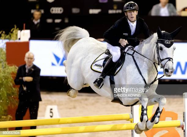 Marcus Ehning of Germany riding Cornado NRW EQU competes in the FEI World Cup Jumping at the Indoor Brabant in Den Boschon March 11 2018 / AFP PHOTO...