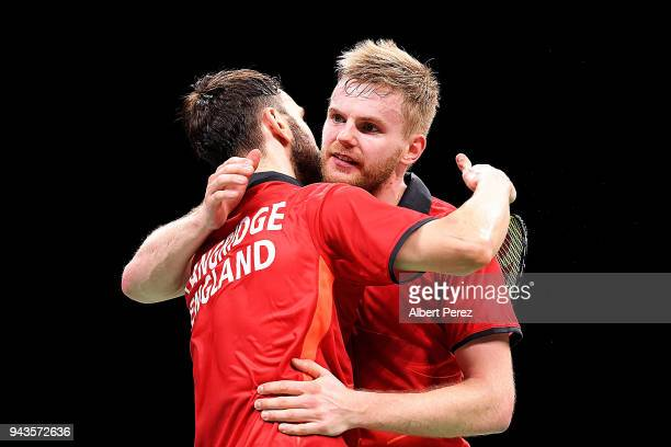 Marcus Ellis and Chris Langridge of England embrace after winning the Badminton Mixed Team bronze medal match against Yong Kai Terry Hee and Danny...