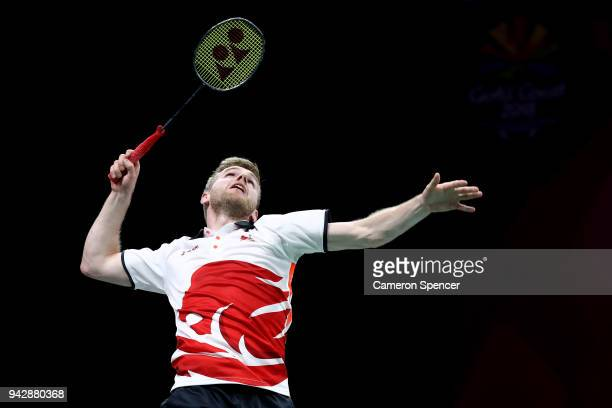 Marcus Ellis of England plays a shot with team mate Chris Langridge of England during the Badminton Mixed Team Quarterfinal against Jason HoShue and...