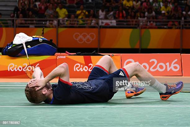 Marcus Ellis of Great Britain celebrates winning match point against Wei Hong and Biao Chai of China during the Men's Doubles Badminton Bronze Medal...