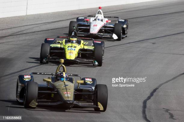 Marcus Ericsson driver of the Arrow Schmidt Peterson Motorsports Honda leads Sebastien Bourdais and Josef Newgarden into turn 2 during the ABC Supply...