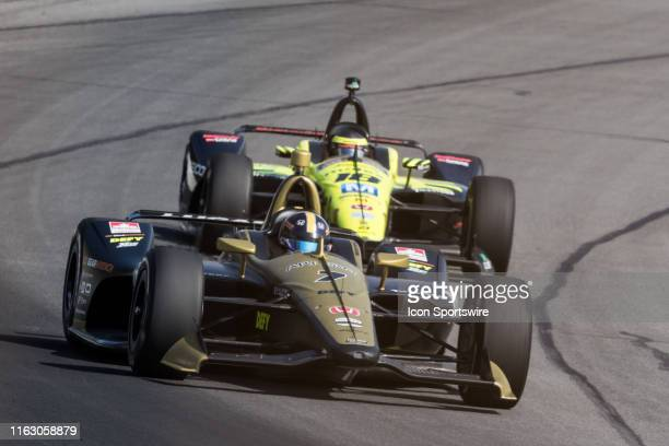 Marcus Ericsson driver of the Arrow Schmidt Peterson Motorsports Honda races into turn 2 followed closely by Sebastien Bourdais during the ABC Supply...