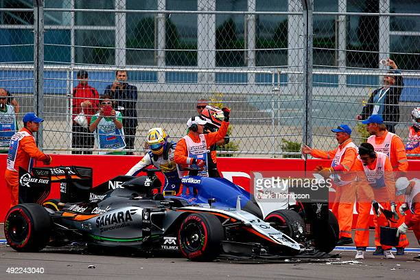 Marcus Ericsson of Sweden and Sauber F1 and Nico Hulkenberg of Germany and Force India get out of their cars after colliding during the Formula One...