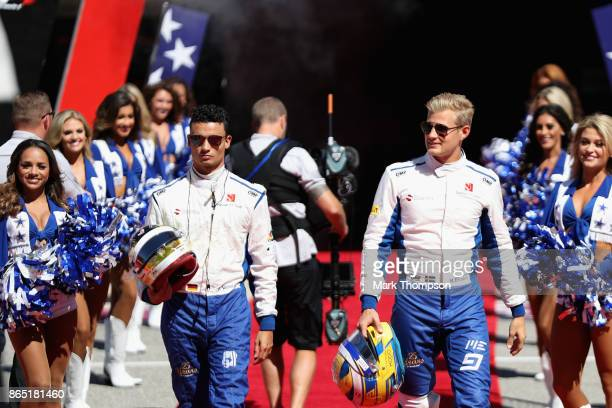 Marcus Ericsson of Sweden and Sauber F1 and Pascal Wehrlein of Germany and Sauber F1 walk to the grid before the United States Formula One Grand Prix...