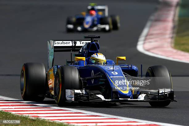 Marcus Ericsson of Sweden and Sauber F1 drives ahead of Felipe Nasr of Brazil and Sauber F1 during the Formula One Grand Prix of Hungary at...