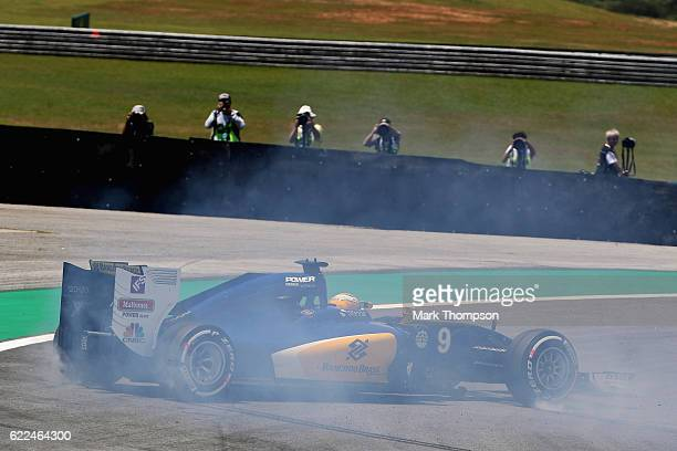 Marcus Ericsson of Sweden driving the Sauber F1 Team Sauber C35 Ferrari 059/5 turbo spins on track and surrounded by photographers during practice...