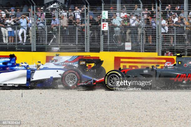 Marcus Ericsson of Sweden driving the Sauber F1 Team Sauber C36 Ferrari tangles with Kevin Magnussen of Denmark driving the Haas F1 Team HaasFerrari...