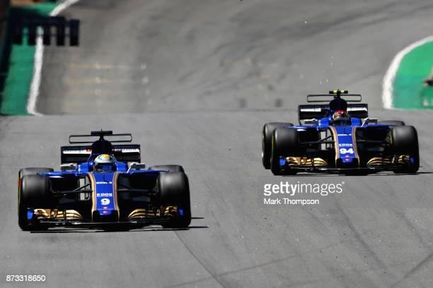Marcus Ericsson of Sweden driving the Sauber F1 Team Sauber C36 Ferrari leads Pascal Wehrlein of Germany driving the Sauber F1 Team Sauber C36...