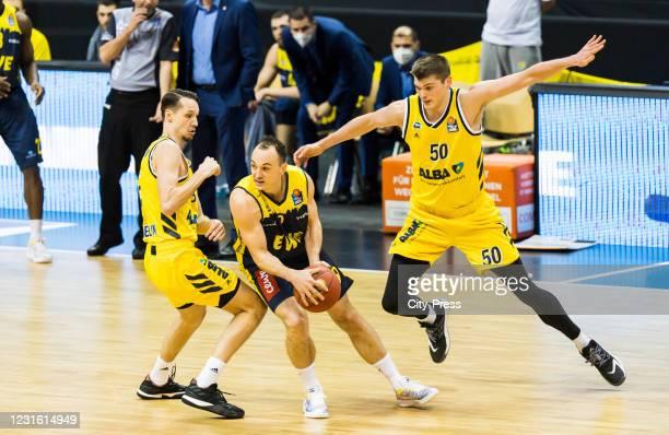 Marcus Eriksson of Alba Berlin, Karsten Tadda of the EWE Baskets Oldenburg and Ben Lammers of Alba Berlin during the game between ALBA Berlin against...