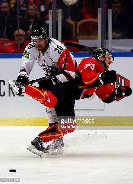 Marcus Fagerudd of Lulea is checked by Joel Lundqvist of Gothenburg during the Champions Hockey League final match at Coop Norrbotten Arena on...