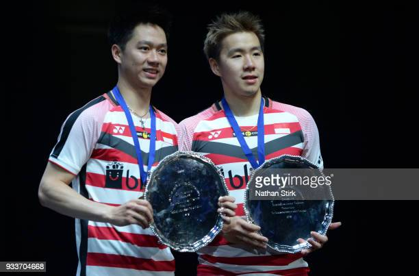 Marcus Fernaldi Gideon and Kevin Sanjaya Sukamuljo of Indonesia hold the trophy as they beat Mathias Boe and Carsten Mogensen of Denmark in the men's...