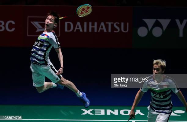 Marcus Fernaldi Gideon and Kevin Sanjaya Sukamuljo of Indonesia compete in the Men's Doubles semi finals match against He Jiting and Tan Qiang of...