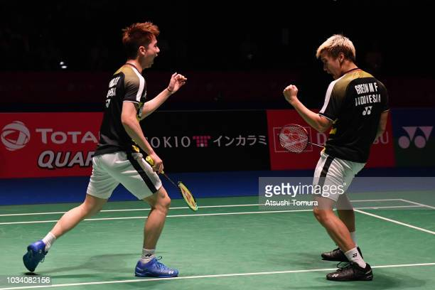 Marcus Fernaldi Gideon and Kevin Sanjaya Sukamuljo of Indonesia compete in the men's doubles final match against Li Junhui and Liu Yuchen of China on...