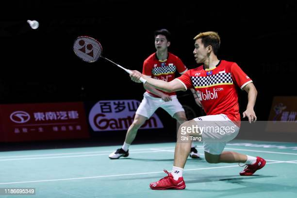 Marcus Fernaldi Gideon and Kevin Sanjaya Sukamuljo of Indonesia compete in the Men's Double final match against Takeshi Kamura and Keigo Sonoda of...