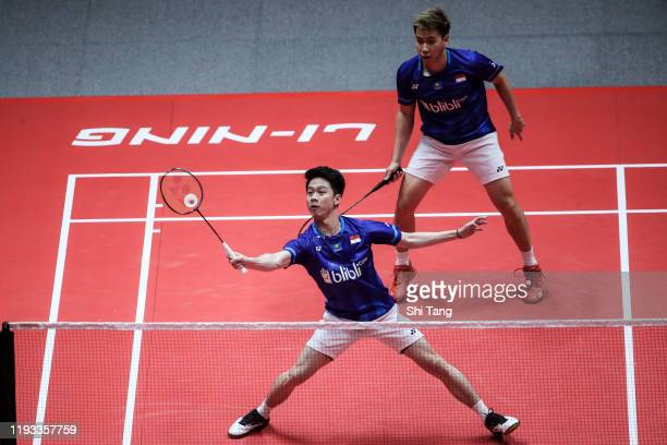 Marcus Fernaldi Gideon and Kevin Sanjaya Sukamuljo of Indonesia compete in the Men's Doubles round robin match against Li Junhui and Liu Yuchen of...