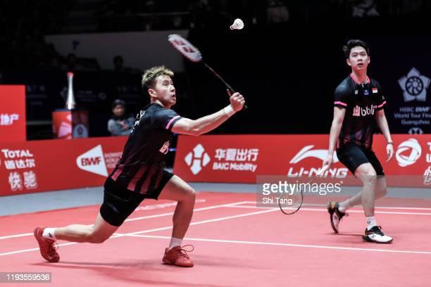 Marcus Fernaldi Gideon and Kevin Sanjaya Sukamuljo of Indonesia compete in the Men's Doubles round robin match against Hiroyuki Endo and Yuta...
