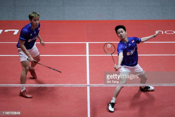 Marcus Fernaldi Gideon and Kevin Sanjaya Sukamuljo of Indonesia compete in the Men's Doubles round robin match against Takeshi Kamura and Keigo...