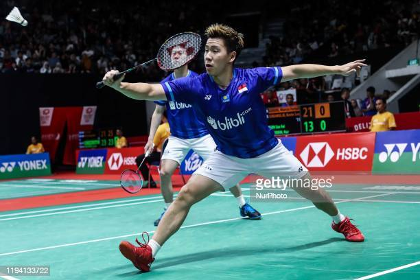 Marcus Fernaldi Gideon and Kevin Sanjaya Sukamuljo of Indonesia competes in the Men's Double quarter final match against Aaron Chia and Soh Wooi Yik...