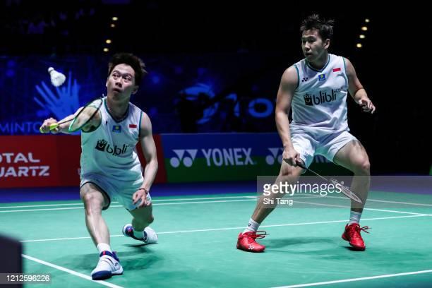 Marcus Fernaldi Gideon and Kevin Sanjaya Sukamuljo of Indonesia compete in the Men's Double final match against Hiroyuki Endo and Yuta Watanabe of...