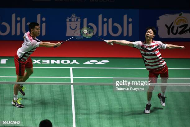 Marcus Fernaldi Gideon and Kevin Sanjaya Sukamuljo of Indonesia compete against Mohammad Ahsan and Hendra Setiawan of Indonesia during the Men's...