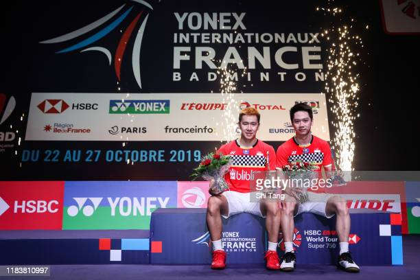 Marcus Fernaldi Gideon and Kevin Sanjaya Sukamuljo of Indonesia pose with their trophies after the Men's Double final match against Satwiksairaj...
