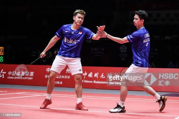 Marcus Fernaldi Gideon and Kevin Sanjaya Sukamuljo of Indonesia react in the Men's Doubles round robin match against Li Junhui and Liu Yuchen of...
