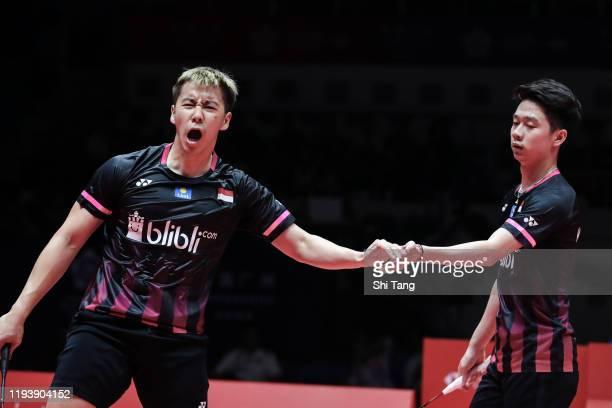 Marcus Fernaldi Gideon and Kevin Sanjaya Sukamuljo of Indonesia react in the Men's Doubles semi finals match against Hiroyuki Endo and Yuta Watanabe...